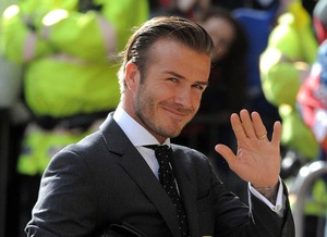 David Beckham waving his left hand